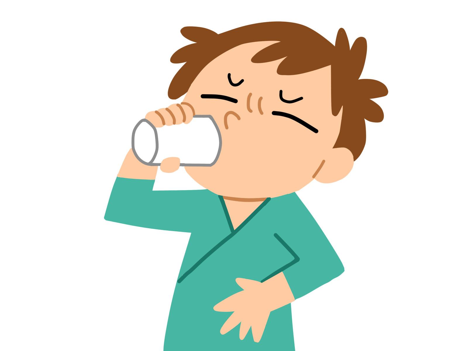 呼気検査のため薬を飲む画像